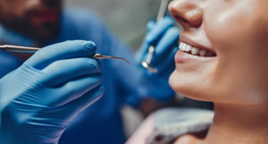 a woman talking to her dentist about general dentistry services