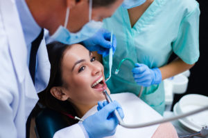a woman at the dentist getting Cosmetic Dentistry Services